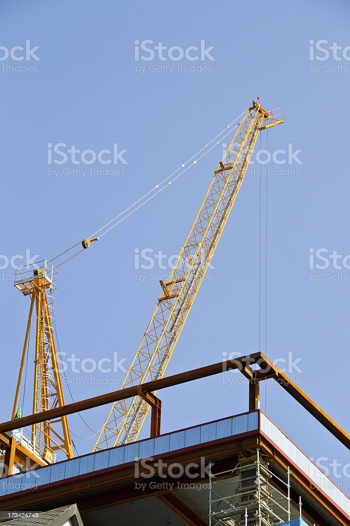 small yellow crane with blue sky background royalty-free stock photo