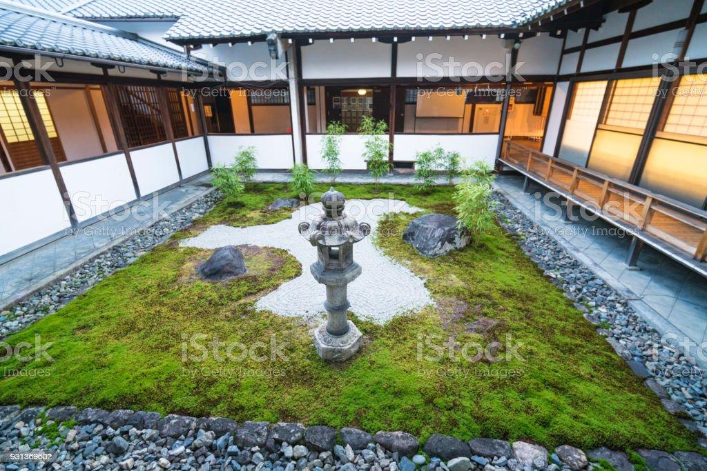 Small Zen Garden With Lantern Between Chionji Temple Walls In