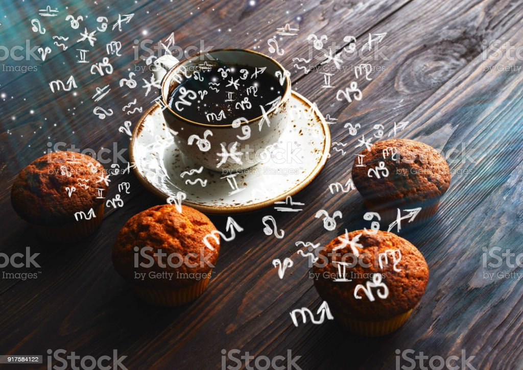 Small zodiac signs take off from a cup with coffee stock photo