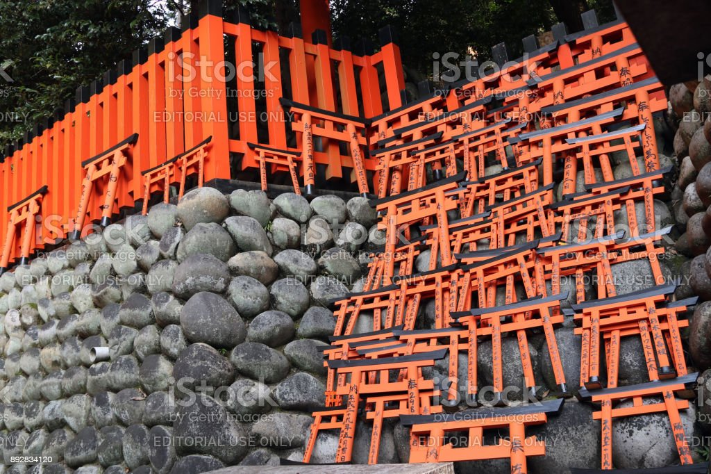 Smaller ornamental sized gate, and have their name painted on it. They are then placed in the smaller sub-shrines and graves on the mountain. stock photo