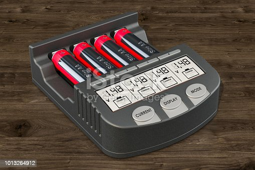 istock Smart AA AAA Battery Charger with batteries on the wooden background,  3D rendering 1013264912