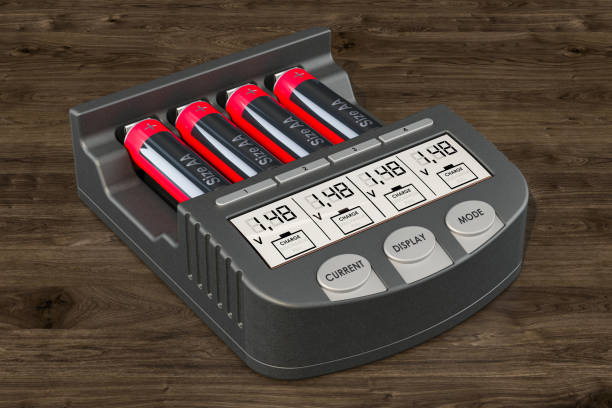 Smart AA AAA Battery Charger with batteries on the wooden background,  3D rendering Smart AA AAA Battery Charger with batteries on the wooden background,  3D rendering battery charger stock pictures, royalty-free photos & images