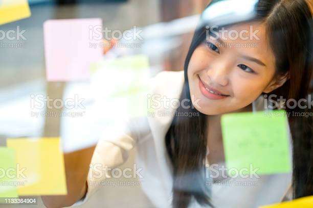 Smart Active Asian Businesswoman Standing Talk To Client On Smartphone Shopfront Background With Confident And Happiness Stock Photo - Download Image Now
