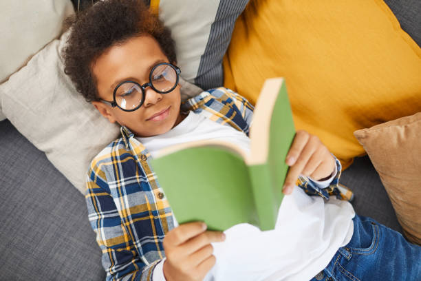 Smart African Boy Reading Book stock photo