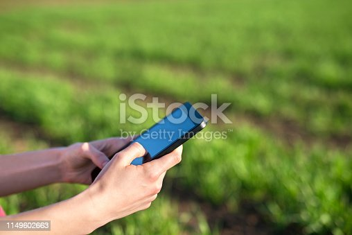 1047941544istockphoto Smart agriculture. Tablet in the field. 1149602663