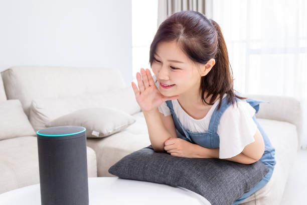 Smart AI speaker concept Smart AI speaker concept - Mom talk to voice assistant at home and feel happy smart speaker stock pictures, royalty-free photos & images