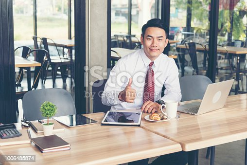 istock Smart and Handsome Engineer Work at the Coffee Shop 1006485874