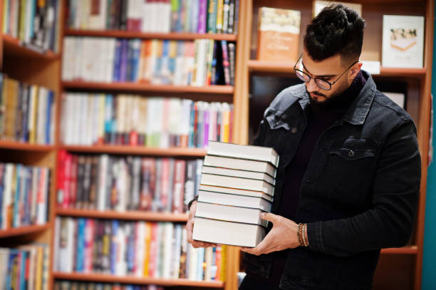 Smart arab student man in library stock photo