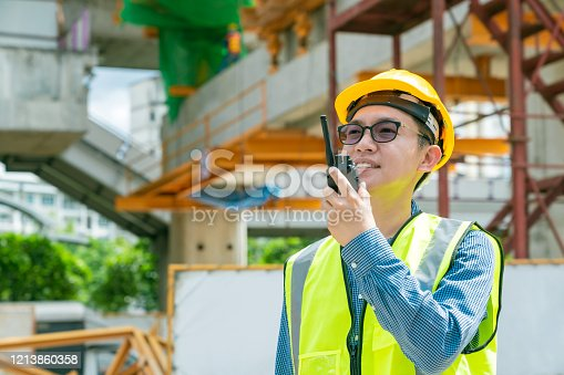 1047558948 istock photo smart asian glasses engineer use radio connection working in site construction 1213860358