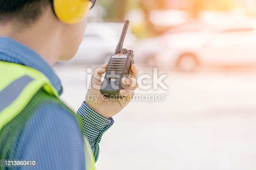 1047558948 istock photo smart asian glasses engineer use radio connection working in site construction 1213860410