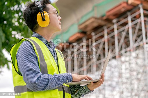 1047558948 istock photo smart asian glasses engineer use radio connection working in site construction 1213860492