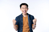 istock smart attractive asian friendly male hand rise up cheerful exited standing and smile with freshness and joyful casual blue shirt portrait white background 1218196957