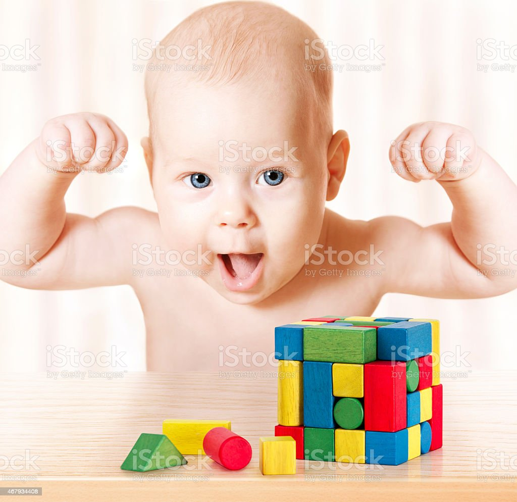 Smart Baby Playing Toy Blocks, Strong Healthy Child Laughing, Success stock photo
