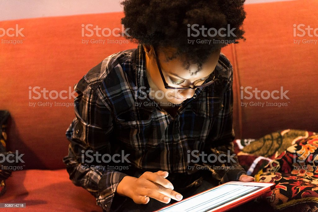 Smart Black American Woman Browsing Internet on Tablet Brooklyn NYC stock photo