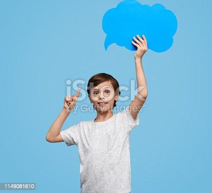 465462550istockphoto Smart boy showing blank speech bubble 1149081610