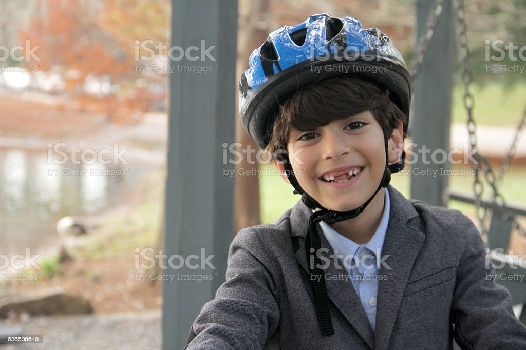 smart boy with blue safety helmet smiling with coat. stock photo
