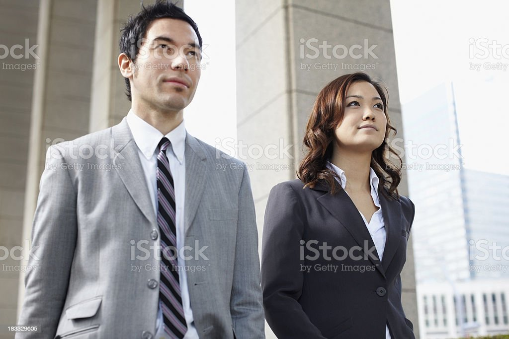 Smart business man and woman in suit walking royalty-free stock photo