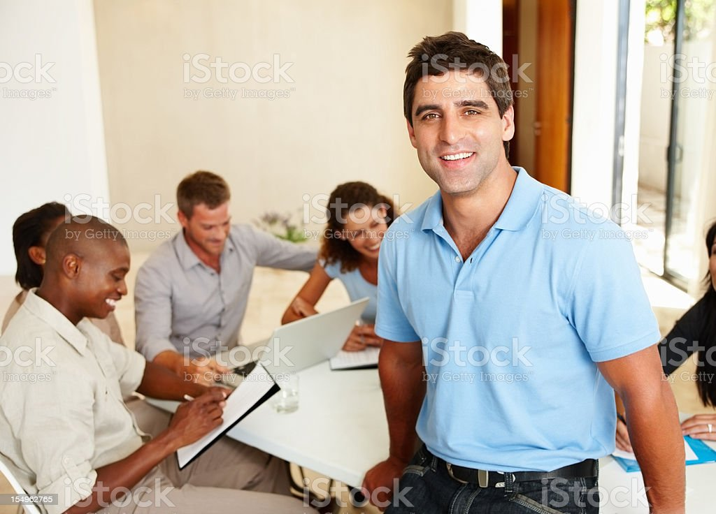 Smart business man smiling during a meeting royalty-free stock photo