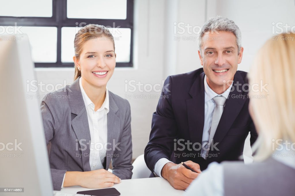 Smart business people sitting at desk in office royalty-free stock photo