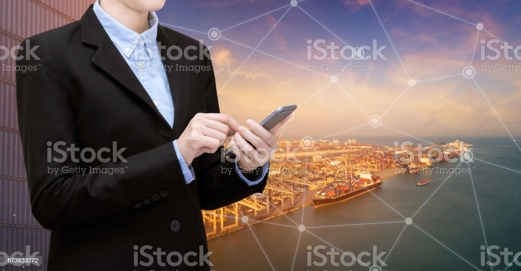 Smart Business woman use smartphone and internet of things technology for Global business connection stock photo
