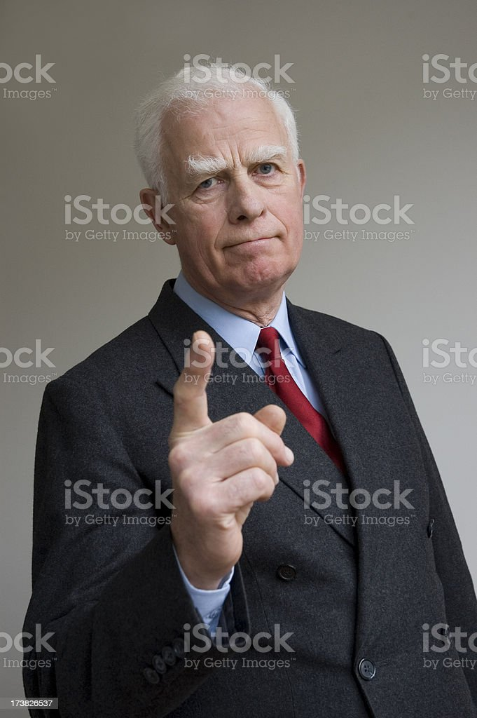 Smart businessman giving stern advice royalty-free stock photo