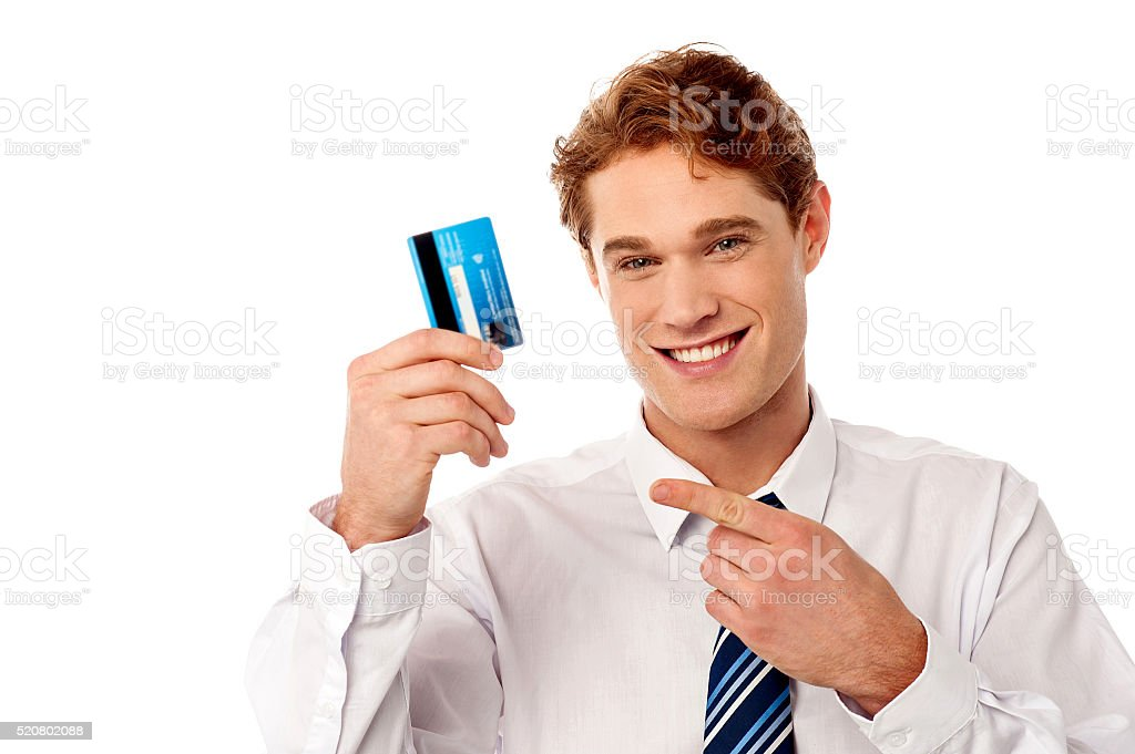 Smart businessman showing credit card stock photo