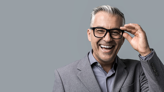 istock Smart businessman with glasses posing 891418898