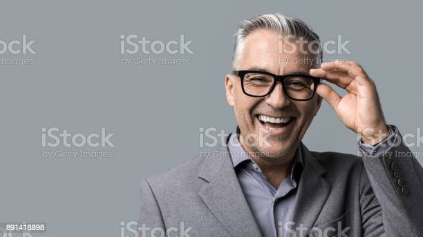 Smart businessman with glasses posing picture id891418898?b=1&k=6&m=891418898&s=612x612&h=grrzszqy5wd222swdt4j8c p4t8s5ez27qa13orojqi=