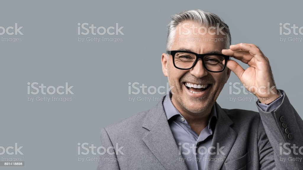 Smart businessman with glasses posing stock photo
