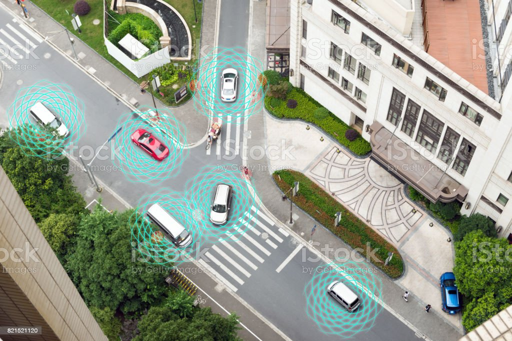 Smart car (HUD) , Autonomous self-driving mode vehicle on metro city road iot concept with graphic sensor radar signal system and internet sensor connect. Above view. stock photo