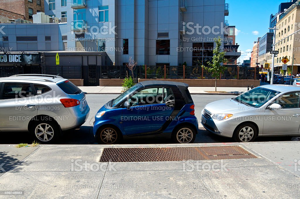 Smart Car parked in small space, New York City street stock photo
