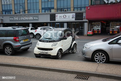 Great Yarmouth uk, 2018-may-26. One advantage of a small car, this driver was able to park in a different way to the rest of the cars.