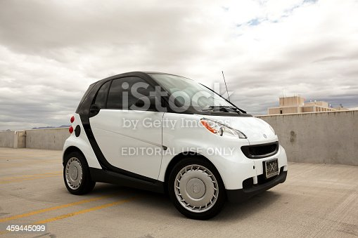 Scottsdale, United States - May 18, 2011: A photo of a parked white Smart Car. The Smart car is a very small and compact car that first debuted in 1998 by Daimler-Benz.