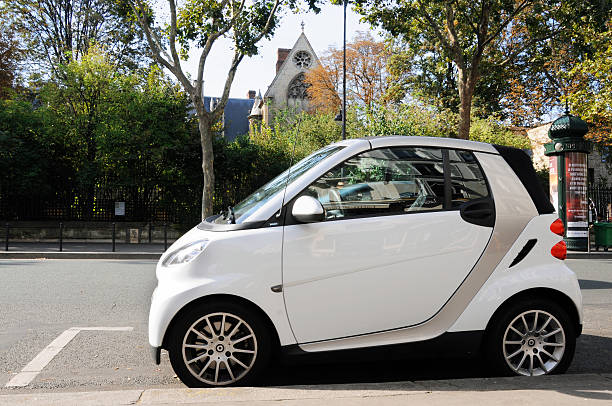 Smart car sideview in a city