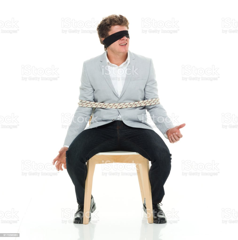 Smart casual dressed man tied up stock photo