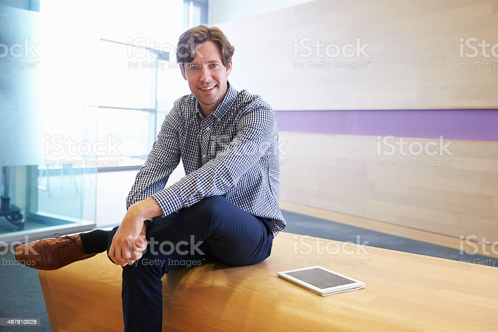Smart Casually Dressed Man With Digital Tablet To Camera Stock Photo