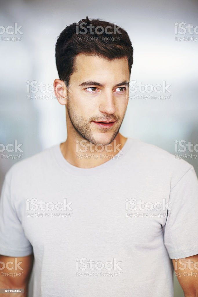 Smart Caucasian man looking away in thought royalty-free stock photo