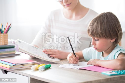 1020504438istockphoto Smart child doing homework 929641398