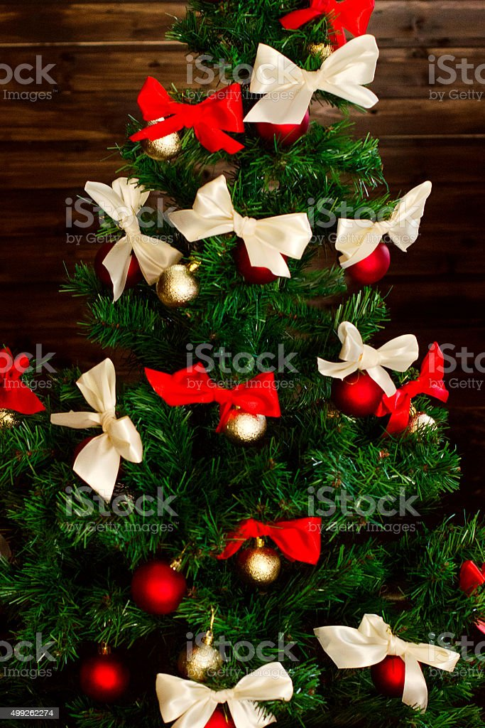 Smart Christmas Tree Decorated With Red And Creamcolored Satin Bow Stock Photo Download Image Now Istock