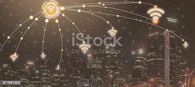 999852584 istock photo Smart city and wireless communication network. 977691302