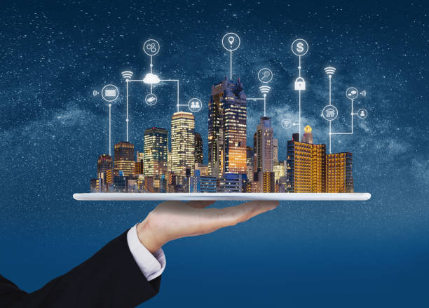 Smart city, building technology, and real estate business. Businessman holding digital tablet with buildings hologram and application programming interface technology Smart city, building technology, and real estate business. Businessman holding digital tablet with buildings hologram and application programming interface technology smart city stock pictures, royalty-free photos & images