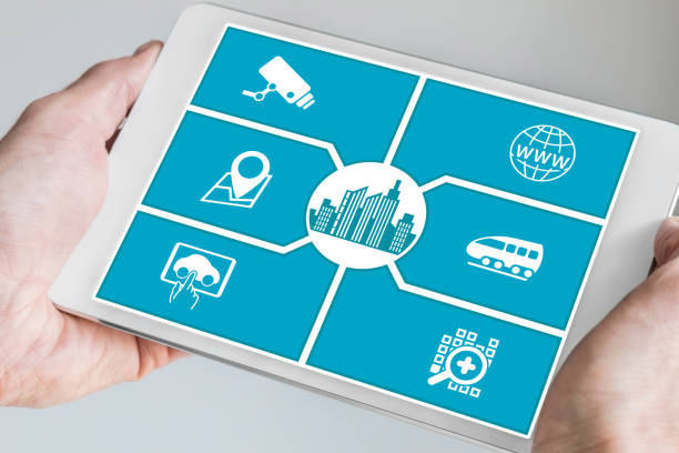 Smart city concept. Hand holding tablet or smart phone stock photo
