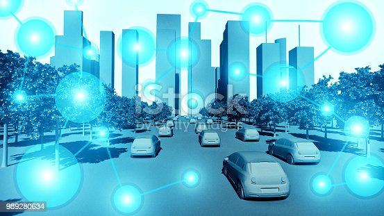 istock Smart city concept with electric cars connected wirelessly while driving on the streets 989280634