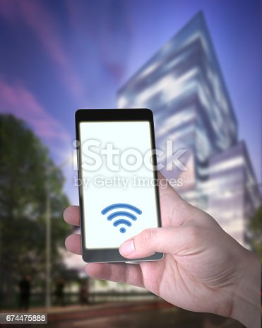 istock Smart City Concept With Smartphone and Wireless Network 674475888