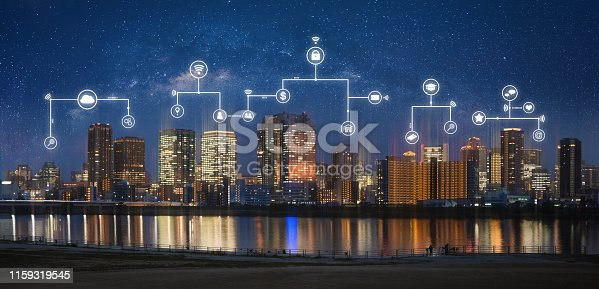 istock Smart city, internet wireless and networking in the city. Modern city at night with internet network and online media application icons 1159319545