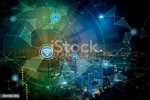 istock smart city night view and wireless communication network 594062350