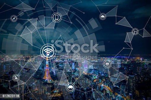 istock smart city night view and wireless communication network 612623118