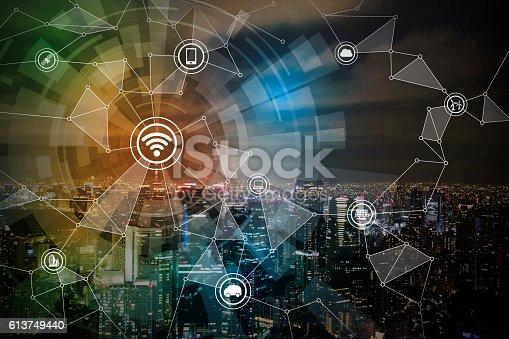 istock smart city night view and wireless communication network 613749440