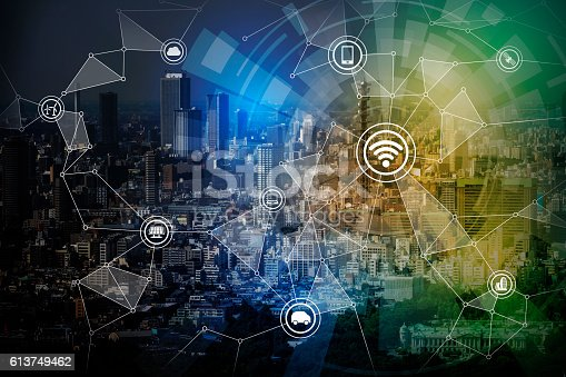 istock smart city night view and wireless communication network 613749462
