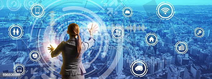 istock smart city panorama and business person controlling futuristic GUI, abstract image visual 696806888